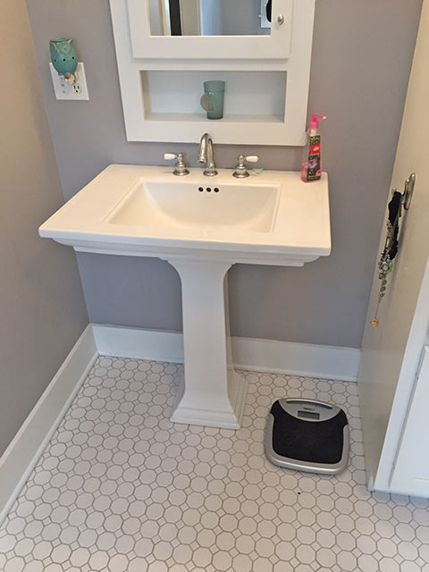New Pedesatal sink installed in remodeling project.