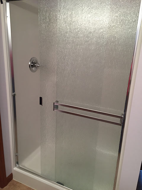 Installation of a frameless door on new shower.